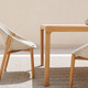 elio_armchair_illum_dining_table_teak_closeup_0.jpg