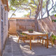 elio_armchair_illum_dining_table_teak_b.jpg