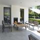 2017 Borek teak alu Twisk lounge chair and coffee table - parasol Rodi graphite 4x3.jpg